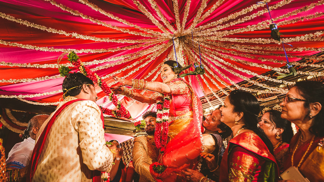 perfect happy moment sharing garlands at indian wedding