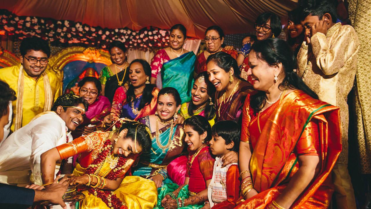 wedding family enjoying with bride and groom